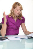 Office worker unhappy with a document — Stock Photo