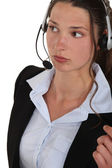 A woman with a headset on. — Stock Photo