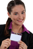 Brunette proudly displaying her business pass — Stock Photo