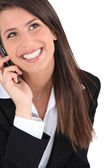 Brunette woman with phone — Stock Photo