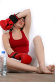 Exhausted woman with boxing gloves — Stock Photo