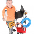 Stock Photo: Plumber showing phone