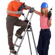 Tradesman posing with his young apprentice — Stock Photo #14898653
