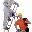 Stock Photo: Painter on ladder and crouching electrician