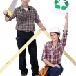 Builders with recycle sign — Stock Photo #14901805