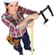 Woman stood with clamp — Stock Photo