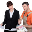Stock Photo: Female architect and male painter