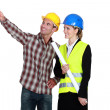 Architect and builder pointing into blank copyspace — Stock Photo #14909891