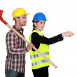 Building worker and woman supervising work on white background — Stock Photo #14909961
