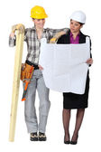 Architect and worker exchanging ideas — Stock Photo