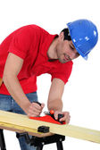 Construction worker planing wood — Stock Photo