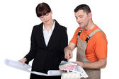 Female architect and male painter — Stock Photo