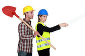 Building worker and woman supervising work on white background — Stock Photo