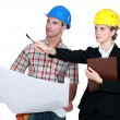 Foreman and architect discussing a project — Stock Photo #14910075