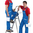 Stock Photo: Two male decorators wearing matching outfits