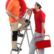Two electricians working together — Stock Photo #14915057