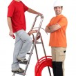 Two plumbers stood with ladder and copper pipe — Stock Photo