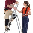 Stock Photo: Co-workers with stepladder