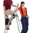 Stock Photo: Tiler and female helper