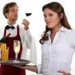 Wine waiter and waitress - Stock Photo