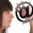 Teen with email symbol Godreau_Lea_140410 - Stock Photo