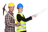Businesswoman and craftsman going to the construction site — Foto Stock