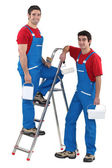 Two male decorators wearing matching outfits — Stock Photo