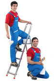 Two male decorators wearing the same outfit — Stock Photo
