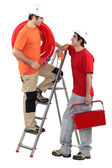 Two electricians working together — Stock Photo