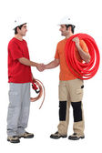 Plumbers shaking hands — Stockfoto