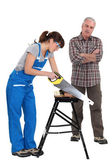 A carpenter and his trainee. — Stock Photo