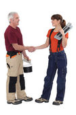 Craftsman and craftswoman shaking hands — Stockfoto
