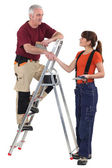 Co-workers with a stepladder — Stock Photo