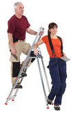 Tiler and female helper — Stock Photo