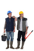 A team of distracted tradesmen — Stock Photo
