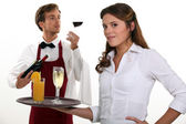 Wine waiter and waitress — Stock Photo