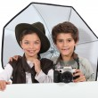 Kids dressed as photographers - Stockfoto