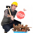 Builder kneeling by recycle box — Stock Photo #14928701