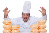 Chef with piles of takeout boxes — Stock Photo