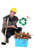 Portrait of carpenter showing recycling logo — Stock Photo