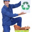 Builder holding recycle sign - Stok fotoraf