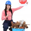 Craftswoman holding a stop sign — Stock Photo