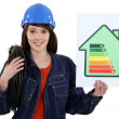 A female electrician promoting energy savings. — Stock Photo #14934695