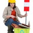 Female builder pointing to recyclable waste — Stock Photo #14934905