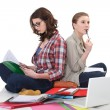 Stock Photo: Female students cramming for exam