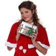 Mrs. Claus holding a Christmas present — Stock Photo