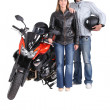 Biking couple with a red motorcycle — Stock Photo