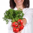 Stock Photo: Woman holding tomatoes