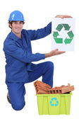 Builder holding recycle sign — Stock Photo
