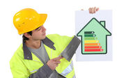 A mason promoting energy savings. — Stock Photo